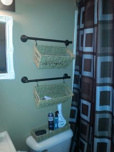 Organization for small bathroom...baskets for our guests. Hmmmmm