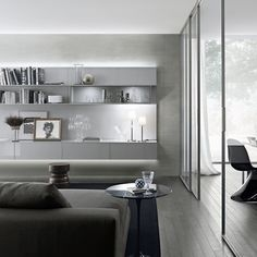 hanging composition with panels in lacquered grigio chiaro glass with upper and lower led lighting, cabinet in transparent grey glass. Sliding Door Systems, Sliding Doors, Living Area, Living Spaces, Living Room, Modern Decor, Modern Design, Cabinet Door Hardware, Interior Decorating
