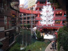 https://flic.kr/p/5ALriL | Canal City in Fukuoka | Canal City is a large, multi-story shopping mall in downtown Fukuoka. It is only a few years old, and it features a beautiful man made canal running through the center of the mall.  The mall is all decorated for Christmas, even though it is  a month and a half away.