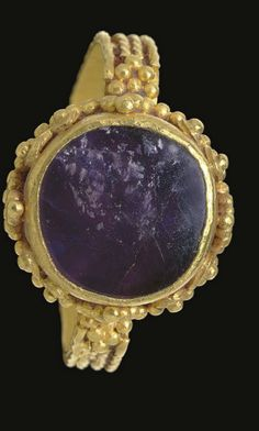 A LATE ROMAN GOLD AND AMETHYST FINGER RING CIRCA 4TH CENTURY A.D.