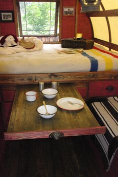 Raised bed with a slide out table! - Put a sliding screen across the sleeping nook (for privacy) and this could be a VERY good option as a Tiny House Full Dining Area... - To connect with us, and our community of people from Australia and around the world, learning how to live large in small places, visit us at www.Facebook.com/TinyHousesAustralia