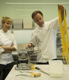 Marcus Wareing showing Sienna Miller how to make pasta on the set of Burnt