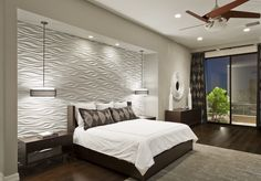 Bedroom with feature wall and hanging pendants