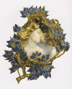 'The Kiss' brooch, by René Lalique, France, circa 1900-02. Gold, enamel, ivory. Signed 'LALIQUE' on the back and on the right.