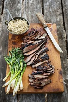 Boneless Leg of Lamb, studded with Garlic Cloves, & marinated in good extra virgin olive oil, lemon juice and zest, greek oregano, and of course some fresh chopped rosemary. Perfect for grilling, and serving to those special people!