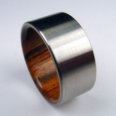 Titanium and wood ring -- Rosewood interior with satin finished Titanium exterior. $199.00, via Etsy.