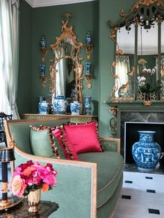 """""""I really believe that a sense of scale is what is most important to an interior designer's aesthetic. Here Carloyne Roehm has put an oversized Chinese vase in front of a fireplace. The scale is perfect - the piece is dramatic but in balance with the rest of the space."""