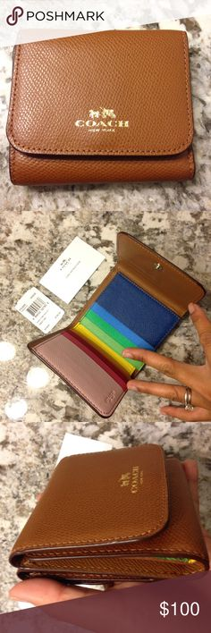 """☀️SALE☀️Coach rainbow color block wallet This cute wallet is perfect for your pocket or small purse.  It's brand new with tag and in perfect condition.  Details : Crossgrain """"saddle"""" colored leather Credit card and multifunction pockets Full-length bill compartments Zip-top closure, fabric lining Outside snap pocket 4 1/4"""" (L) x 3 3/4"""" (H) Coach Bags Wallets"""
