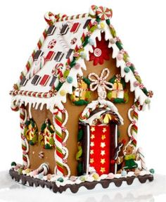 Looking good enough to eat, this gingerbread house from Kurt Adler boasts a happy gingerbread man perched outside a delicious house full of sparkling gumballs, swirly peppermints and so much more! Als Gingerbread Village, Gingerbread Decorations, Christmas Gingerbread House, Gingerbread Man, Gingerbread Cookies, Christmas Decorations, Christmas Goodies, Christmas Treats, Christmas Baking
