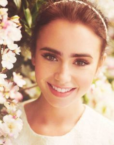 Lily Collins . . . I love her! She's such a talented actress and I'm so inspired by her in her acting, style, everything!