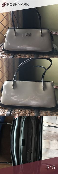 Used Beijo purse Used Beijo purse, worn only a hand full of times. Pictures of some spots. Good condition. A natural metallic color with black accent beijo Bags Shoulder Bags