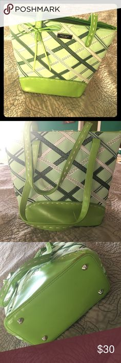 """Green & white Ribbon pattern Kate Spade Handbag This adorable purse has been sitting in my closet for ages. It needs to be cleaned, and I don't think the marks on the front of it (see pics) are permanent, but I have a sick toddler right now, which means I barely have time to post things let alone clean old purses that I don't want anymore. That means you get it for a steal!  Opening is 11.5"""" at zip, purse in 9.5"""" deep, and base measures 8""""x4.5"""". Straps are 19"""" long. kate spade Bags"""