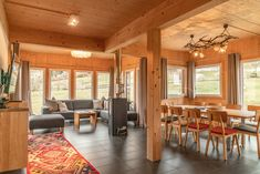 The spacious living and dining area Alpine Chalet, Dining Area, Conference Room, Interior Design, Modern, Table, Furniture, Home Decor, Nest Design