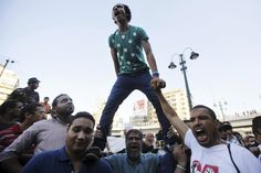 STANDING TALL: Supporters of the Muslim Brotherhood and ousted President Mohammed Morsi protested at Al Istkama mosque at Giza Square, south of Cairo, Sunday. The European Union said it will 'urgently review' its relations with Egypt amid a deadly crackdown on protesters. (Amr Abdallah Dalsh/Reuters)