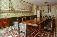 Dining Room in Stoclet Palace, Brussels. The inlaid wall murals are by Gustav Klimt.