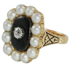 Victorian Pearl Black Enamel Diamond Gold Ring. Victorian yellow gold and black enamel ring prong set with one European cut round diamond weighing .46 carat, I color, SI clarity and 12 cultured pearls. c 1910