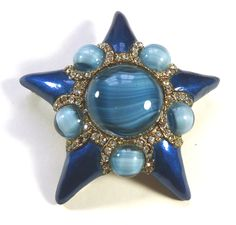 A vintage blue star brooch by Capri of New York. Photographed by Gillian Horsup.