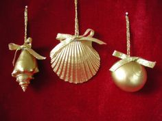 DIY idea: gold painted shell ornaments - or just leave them natural for keepsake Christmas ornaments to commemorate family vacation for that year.