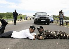 Several hundred ANC supporters blocked DA leader Helen Zille's planned inspection of President Jacob Zuma's Nkandla residence and police refused Zille permission to proceed along the road to the residence for fears over her safety.