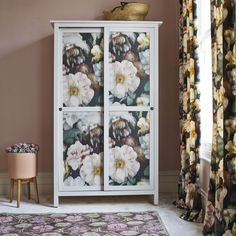White bedroom wardrobe decorated with large-scale floral wallpaper