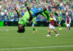 Seattle Sounders' Obafemi Martins does a backflip after he scored a goal against the Colorado Rapids, Saturday, April in the second half of an MLS soccer match in Seattle. The Sounders defeated the Rapids (AP Photo/Ted S. Mls Soccer, Soccer Kits, Basketball Jersey, Soccer Jerseys, Obafemi Martins, Football Celebrations, Colorado Rapids, Seattle Sounders, Soccer Match