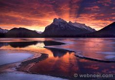 """The Beginning"" - Banff National Park, Alberta. ""The most amazing light show I have ever seen, captured over Mount Rundle in Banff National Park, Alberta. Beautiful Landscape Photography, Beautiful Landscapes, Nature Photography, Landscape Photos, Famous Photography, Reflection Photography, Popular Photography, Photography Courses, Land Art"