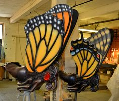 Haverhill Artist William Rogers Paints Life onto the Creatures for the Greenway Carousel, Boston. Different butterflies with different shapes and coloration sculpted by Jeff Briggs