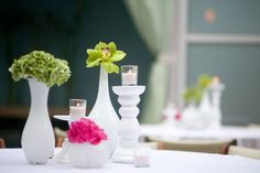 Hate the flowers BUTTT we could spray paint mismatched vases for table center pieces too on the cheap!