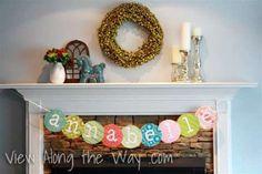 Baby shower decoration idea: Scrapbook paper banner DIY with tutorial