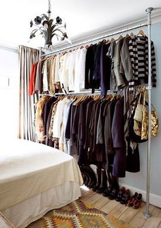 No closet? No problem. 9 ways to store your clothes when you don't have a closet.: Using pipes as closet rods