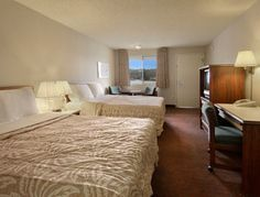 Standard Two Queen Bed Room at the Days Inn Auburn in Auburn, Washington