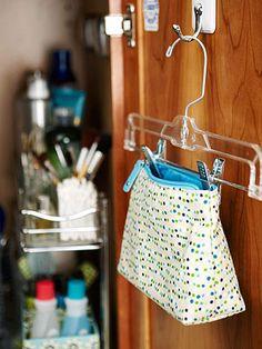 Hang cosmetic bag inside door with hanger