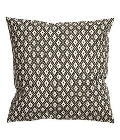 Natural white/charcoal gray. Cushion cover in woven cotton fabric with a printed pattern and concealed zip.