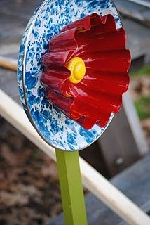 DIY: Metal Yard Art Jello Mold + Drawer Pull + Metal Pie Plate = flower (although, if that's an old blue swirl granite pie plate = expensive mistake.)