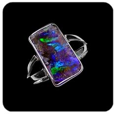 Large rectangle boulder opal with blues, greens and purples set in split sterling silver band. Ref code: 5475. Opal ring - suit ladies or gents fashion jewelry (jewellery)