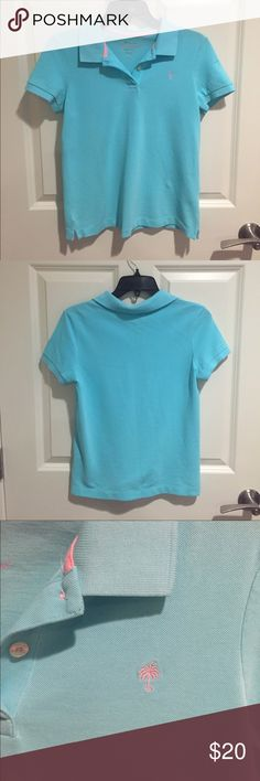 """Resort Fit"" Light Blue Polo This polo is in gently used condition. It is Lilly Pulitzer's resort fit which is a more regular fit than skinny. It has a pink embroidered Lilly logo. Lilly Pulitzer Tops Tees - Short Sleeve"