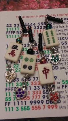 Mahjongg tile cell phone plugs with hearts - for your Mahj ladies and their cell phones!
