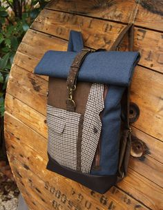 Brown & blue upcycled roll top backpack using parts from a men's vintage pied de poule suit and cork fabric, by 'eating the goober'