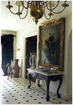 english country chic, updated english country, equestrian, taxidermy, antlers, brass chandelier, marble floors, entryway, foyer, ralph lauren, portraits, greyhound, entryway console table