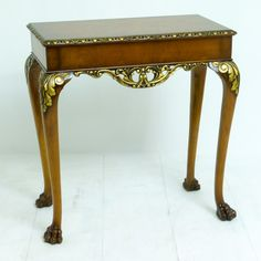 A small walnut and parcel gilt early 18th Century style side table circa 1920. http://witchantiques.com/walnut-side-table.html