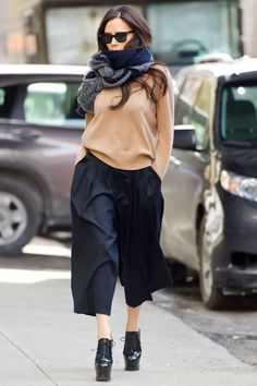 Victoria Beckham wears culottes with heels, a loose jumper and scarf