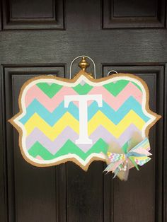 Easter chevron burlap door hanger by carynnscreations on Etsy---I would love to have this hanging on my front door this Spring! Though, I could probably do without the bow thing in the lower corner---a little fussy for my taste.