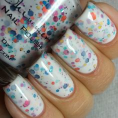 Full Bloom Ahead. When winter comes to a draw and spring is near, bulbs start peeking through the snow. While waiting for spring to officially start, pops of purple, pink, yellow and blue litter flower beds across the nation. This white based polish is loaded with small, medium and large hex glitters in fuchsia, navy, teal, gold and orange; colors reminiscent of those floral tones that signal spring is near.