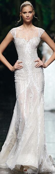 Manuel Mota, 2013.  Pretty white gown.  Could even be worn as a wedding dress!