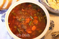 My Favorite Hamburger Soup - A cafeteria lunchroom favorite, this soup from days long gone by and my all time favorite, made with a tomato and beef broth base, ground beef, a mixture of veggies and seasonings, and flavor boosters - all pantry staples. Make a double batch because this freezes nicely.