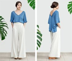 """High waisted palazzo pants with pockets. Cut with a high-rise fit, softly pleated to flatter at the front, with an elasticated waistband at the back- for that great fit. It could be made in jersey cotton fabric for casual everyday use or in satin fabric for weddings and parties.  *Lead-time is 2 weeks, excluding shipping time.  ▶Color: Ivory, Black or Grey  ▶Material: 100% cotton or Satin  Here's a size guide:  size S (US 4-6, UK 8-10) bust: 85-90 cm / 33.5""""-35.5"""" waist: 66-71 cm / 26""""-28""""…"""