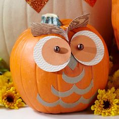 Paper Owl Pumpkin  Cut basic paper shapes to create an oh-so-adorable owl pumpkin. Crafts glue will secure the paper to the base; straight pins and crafts beads work well for eyes.