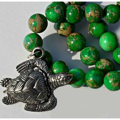 Sea Turtle Pewter Pendant with Multicolor Green Bead Necklace (37 CAD) ❤ liked on Polyvore featuring jewelry, pendants, beading jewelry, pewter pendant, turtle jewelry, charm pendant and tri color jewelry