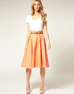high waist, belts, simple colors. love it!  I love the long belted skirt with a simple tee and heals, this will put all of my vintage skirts to work this fall
