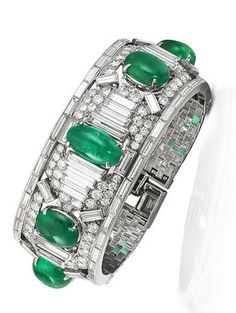 A fine art deco emerald and diamond cuff, by Cartier, circa 1925 The old brilliant-cut diamond cuff set with a row of five emerald cabochons, set between baguette-cut diamond borders and accents, completed by a brick-link bracelet strap with a single and baguette-cut diamond clasp, diamonds approximately 21.00 carats total, signed Cartier, numbered